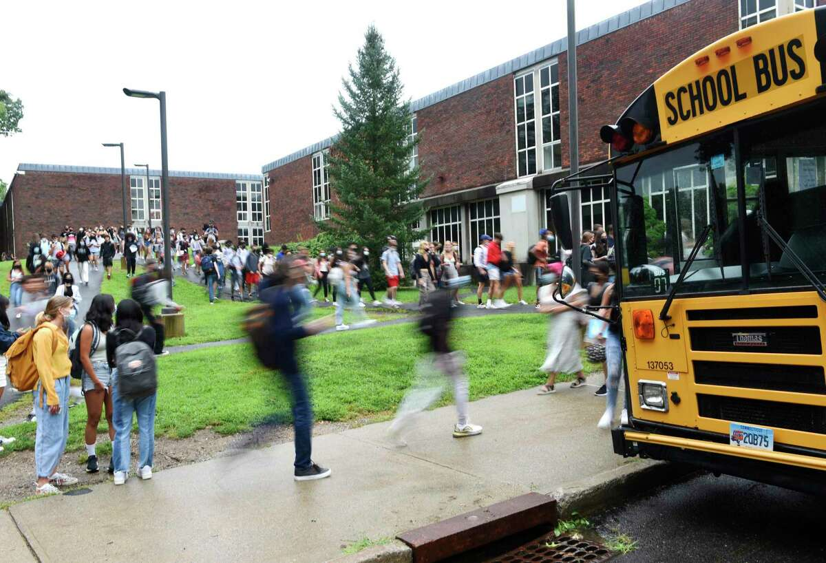 Students are dismissed after the first day of the 2021-2022 school year at Greenwich High School in Greenwich, Conn. Wednesday, Sept. 1, 2021.