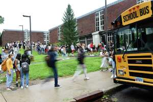 Students are dismissed after the first day of the 2021-2022 school year at Greenwich High School in Greenwich, Conn. Wednesday, Sept. 1, 2021. Greenwich Public Schools students across all grade levels returned for in-person learning Wednesday.