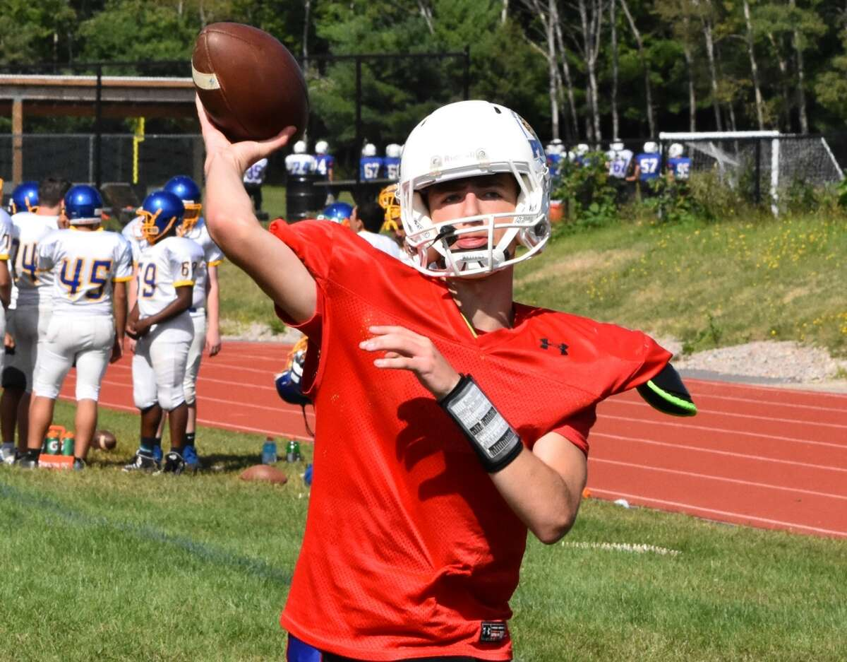 Quinnebaug Valley quarterback Mike Merrill warms up at a scrimmage at Ponaganset high school, North Scituate, RI on Saturday, August 31, 2019.
