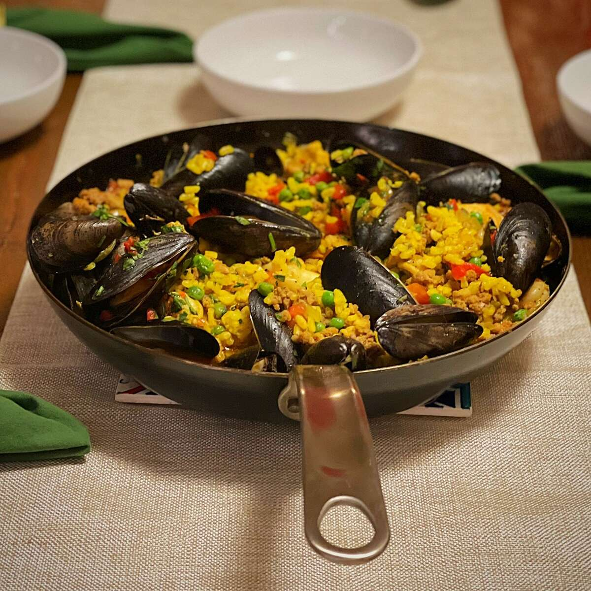 The finished paella Valenciana on the table.