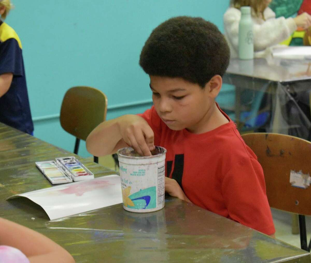 Students in kindergarten through eighth grade gathered at Artworks on Wednesday afternoon for a watercolor creativity challenge. After painting a watercolor picture, instructor Leanna Grant taught them how to see hidden shapes and images in their creations. (Pioneer photo/Olivia Fellows)