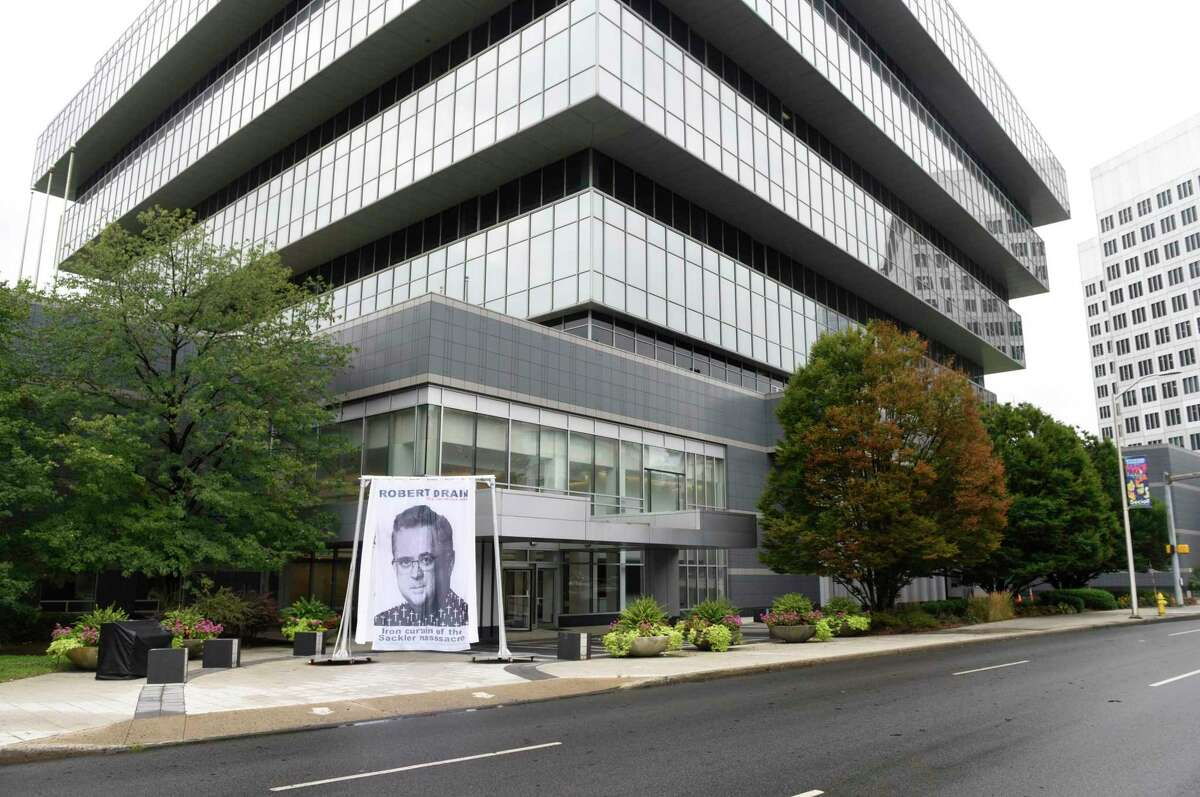 A curtain depicting Judge Robert Drain, who is presiding over Purdue Pharma's bankruptcy case, is displayed outside Purdue's headquarters at 201 Tresser Blvd in downtown Stamford, Conn., on Wednesday, Sept. 1, 2021.
