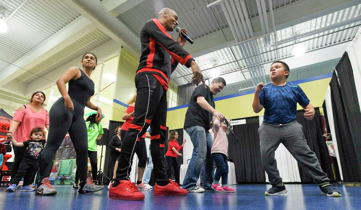 """Participants dance to music as Billy Blanks Jr. leads a """"Dance it Out Class"""" health and wellness demonstration during the seventh annual Health Wellness & Sports Expo 2018 at Chelsea Piers Connecticut on Saturday, Oct. 20, 2018 in Stamford, Connecticut. The event was presented by WABC-TV, showcasing a wide range of health education by Stamford Health, fun activities for children, plus the latest information, products and services from over 100 exhibitors."""