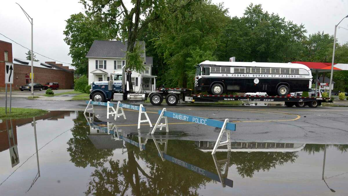 Street flooding for Tropical Storm Henri closed down part of Main Street at Wooster Street on Monday, August 23, 2021, in Danbury, Conn.
