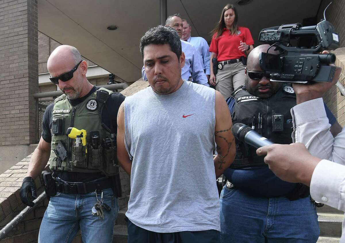 Joaquin Garcia is transported from the Beaumont Police Headquarters to jail after being interviewed by policeinn regards to the stabbing death of Norlan Moreno. Garcia was arrested in Victoria, Texas, Tuesday night. Photo made Thusday, April 22, 2021 Kim Brent/The Enterprise