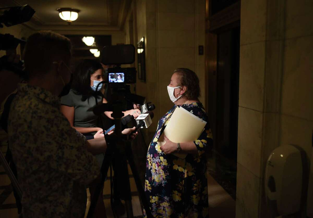 State Sen. Liz Krueger talks to reporters after meeting with Senate Majority Leader Andrea Alice Stewart-Cousins before the start of a special session on Wednesday Sept. 1, 2021, at the Capitol in Albany, N.Y.