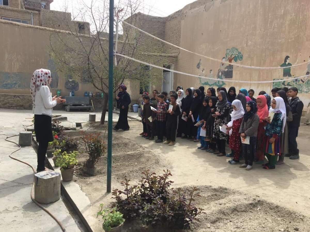 Razia, in the white shirt, teaching some of her students in Kabul.