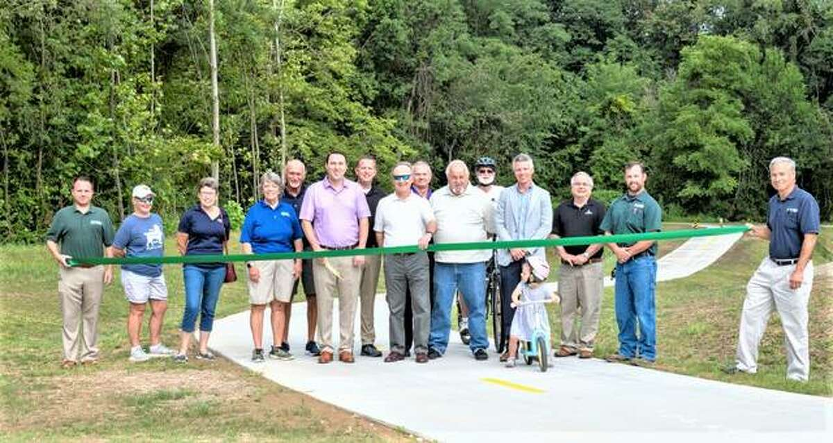 Officials prepare to open a 300-foot connector from Madison County Transit's Schoolhouse Trail to the 51-acre Pleasant Ridge Park in Maryville Wednesday. Participants included MCT GIS Specialist David Cobb, left, Maryville Parks and Recreation Board members Jane Baker, Colleen Seiffert, Sharon Petty, and Bob Hunter; MCT Board Members Chris Guy and Allen Adomite; MCT Board Chairman Ron Jedda; Maryville Mayor Craig Short; MCT Board Member Andy Economy; MCT Managing Director SJ Morrison; Charlie Juneau of Juneau Associates; MCT Assistant Project Manager Jon Martin; and MCT Director of Engineering Mark Steyer.