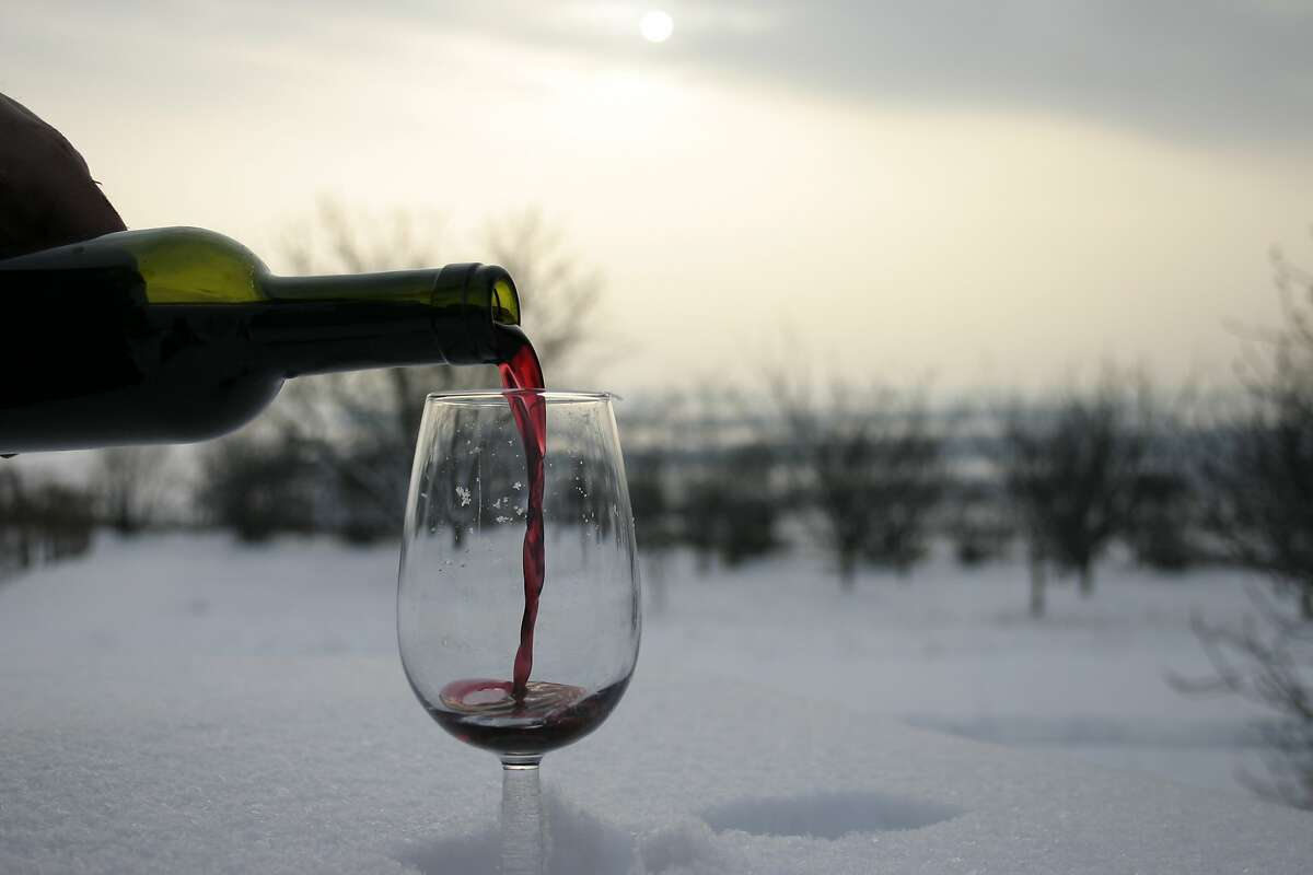 The ideal way to serve a glass of red wine. If you don't have snow available, a refrigerator will do.