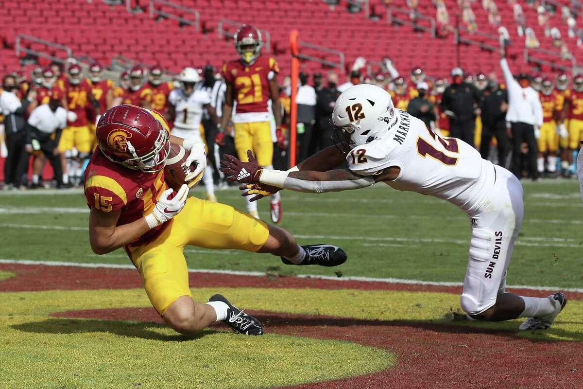 LOS ANGELES, CALIFORNIA - NOVEMBER 07: Drake London #15 of the USC Trojans catches a touchdown pass as Kejuan Markham #12 of the Arizona State Sun Devils defends during the second half of a game at Los Angeles Coliseum on November 07, 2020 in Los Angeles, California. (Photo by Sean M. Haffey/Getty Images)