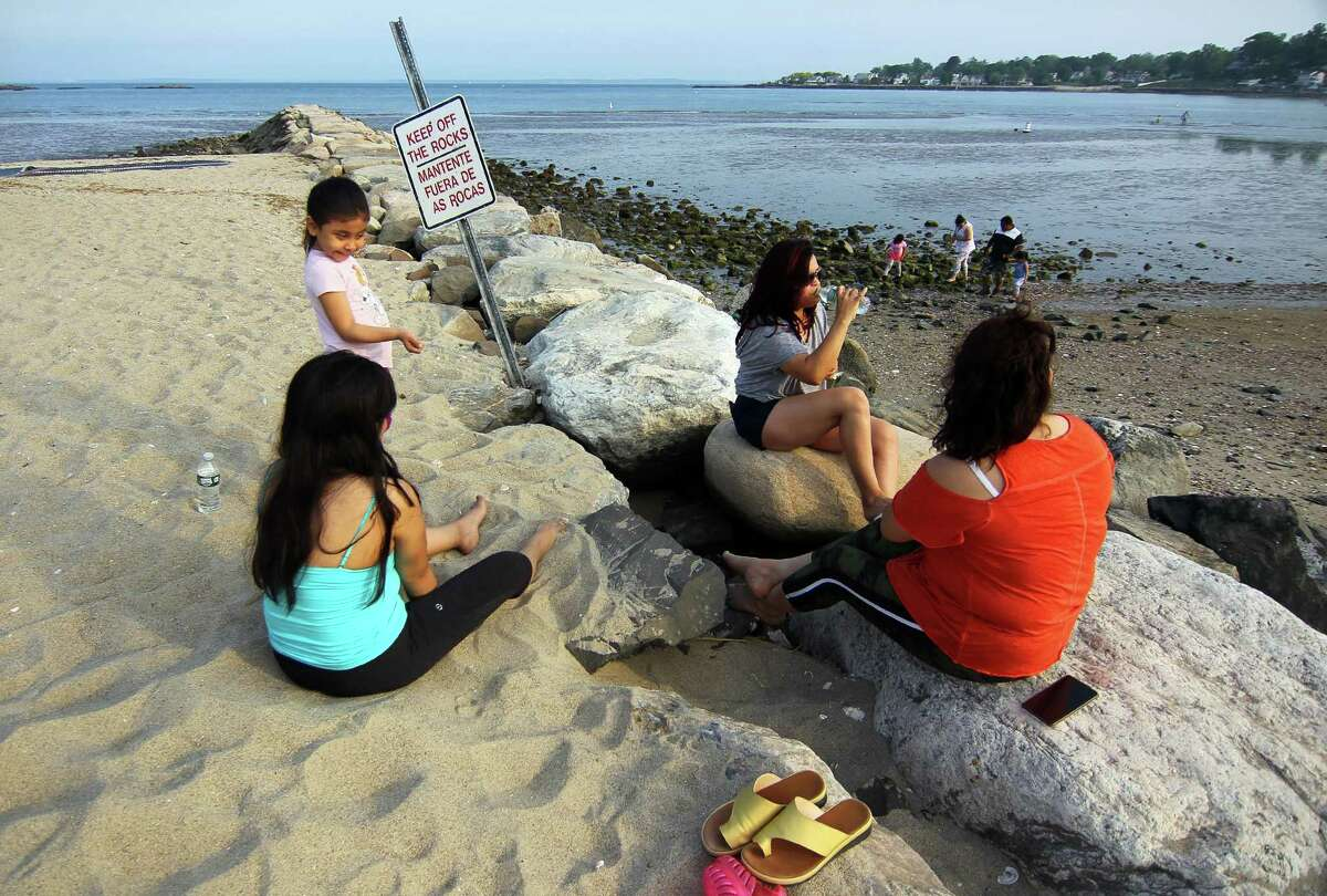 Residents enjoy Cummings Beach in Stamford, Conn., on Wednesday May 26, 2021.