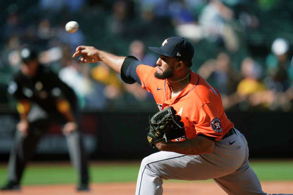Houston Astros relief pitcher Yimi Garcia throws to a Seattle Mariners batter during the seventh inning of a baseball game Wednesday, Sept. 1, 2021, in Seattle. (AP Photo/Elaine Thompson)