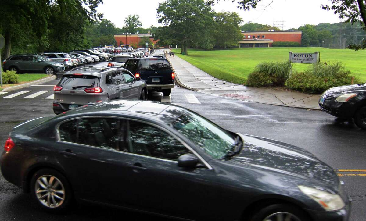 Traffic backs up at Roton Middle School in Norwalk on Wednesday. Traffic on Highland Avenue stretches from Roton Middle School north to Brien McMahon High School and Brookside Elementary School.