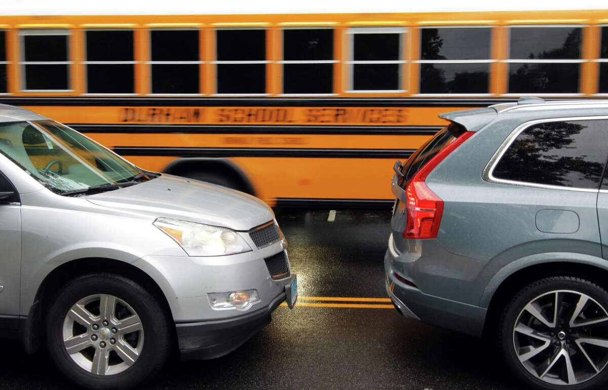 A school bus enters Roton Middle School as traffic backs up on Highland Avenue in Norwalk, Conn., on Wednesday September 1, 2021. Traffic on Highland Avenue stretches from Roton Middle School north to Brien McMahon High School and Brookside Elementary School.