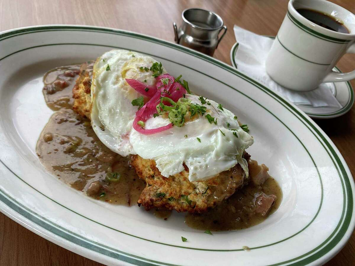 Biscuits with pastrami gravy and fried eggs are part of the breakfast menu at The Hayden, a Jewish-style deli and diner on Broadway.