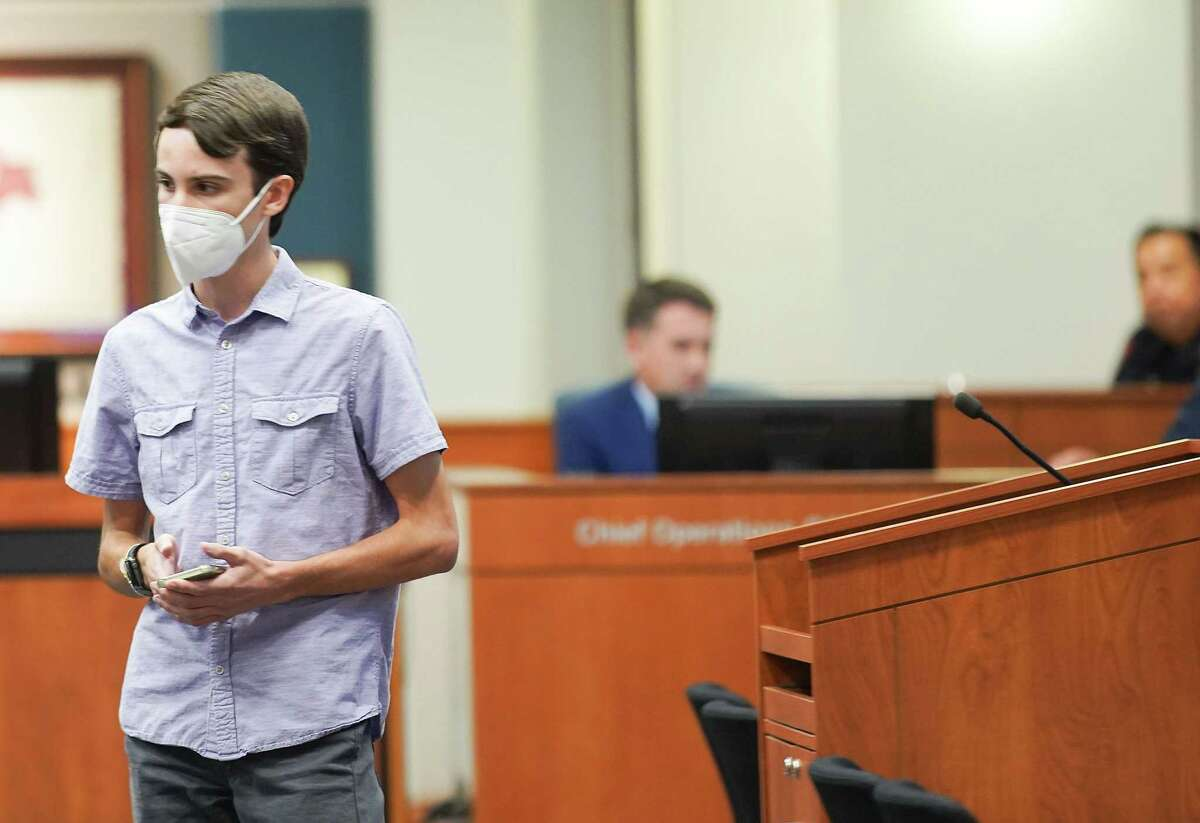 Cameron Samuels, a senior at Seven Lakes High School, leaves the podium after addressing the Katy ISD Katy ISD Board of Trustees to plea that they require masks in schools. At the meeting, the board approved the district's proposed COVID protocols, which do not include mandating masks, on Monday, Aug. 30, 2021.