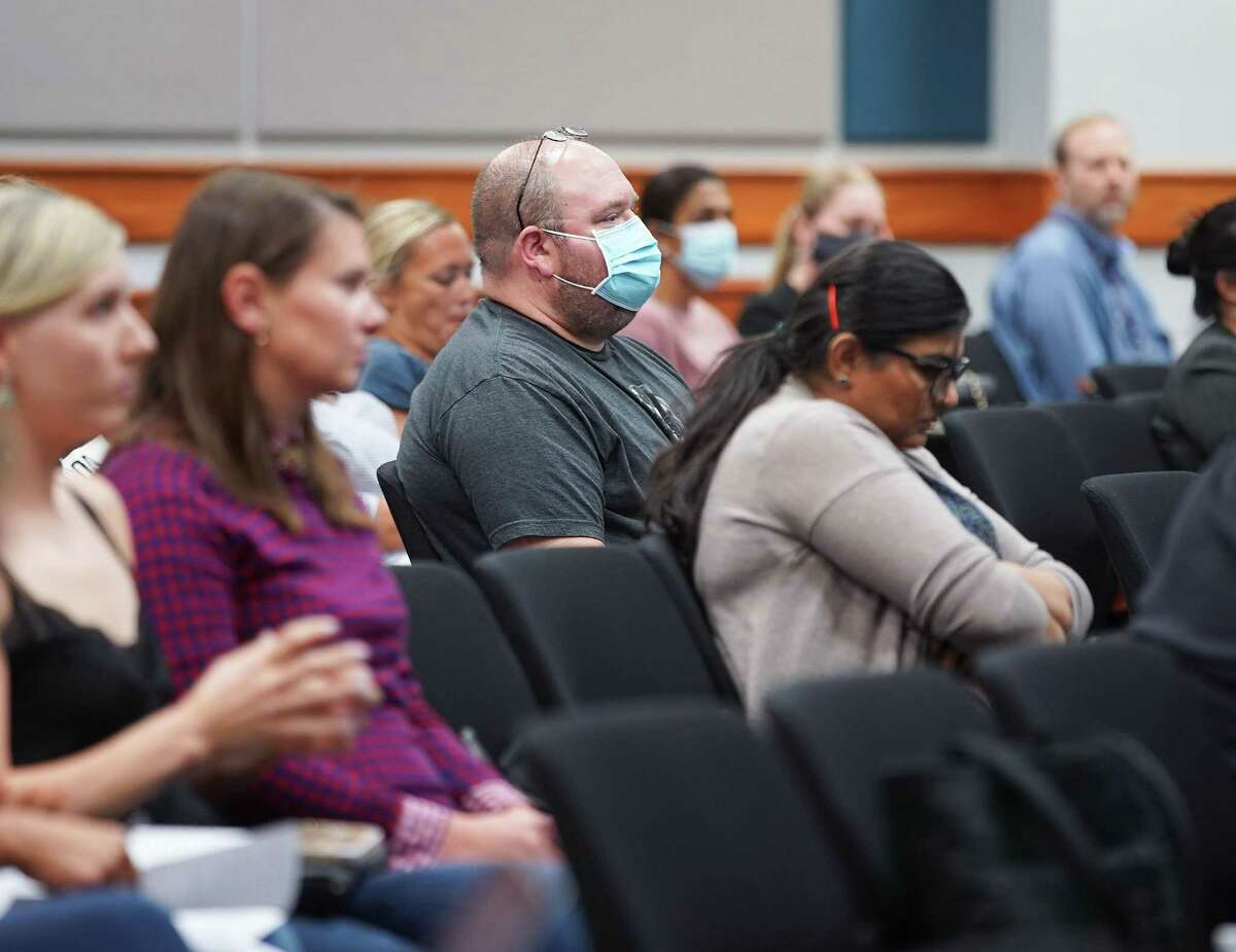 Attendees, mostly unmasked, listen to speakers at a Katy ISD Board of Trustees meeting about COVID protocols on Monday, Aug. 30, 2021. Some parents and students asked the board to change course and mandate masks to slow the spread of the virus. The approved COVID mitigation measures do not include mask requirements.