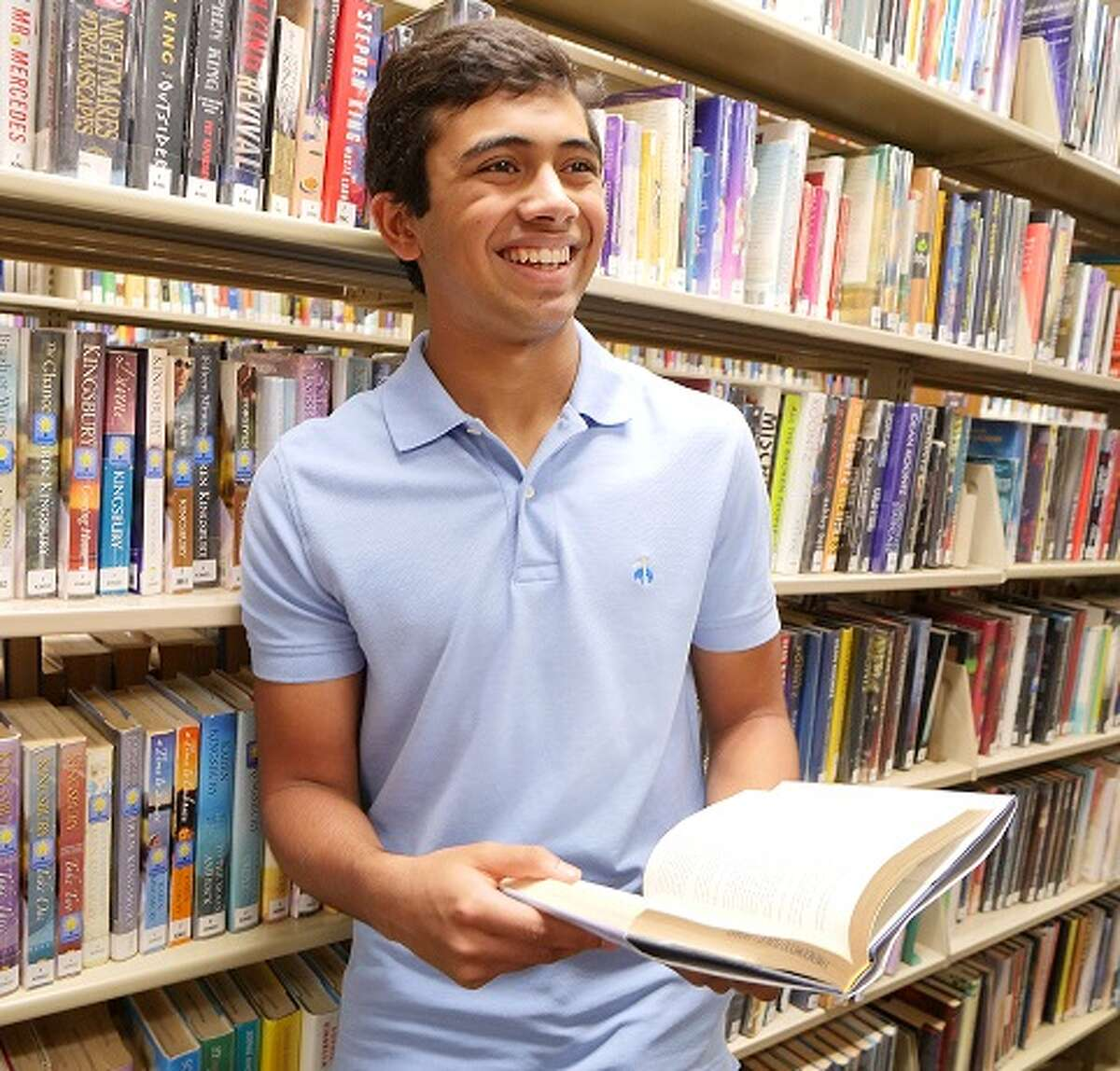 Friendswood High School sophomore Arnav Goel, shown, and Clear Lake High School graduate Raaghav Kavuri founded Act Kind Organization to collect resources - including donated library books - for those in need during the pandemic.
