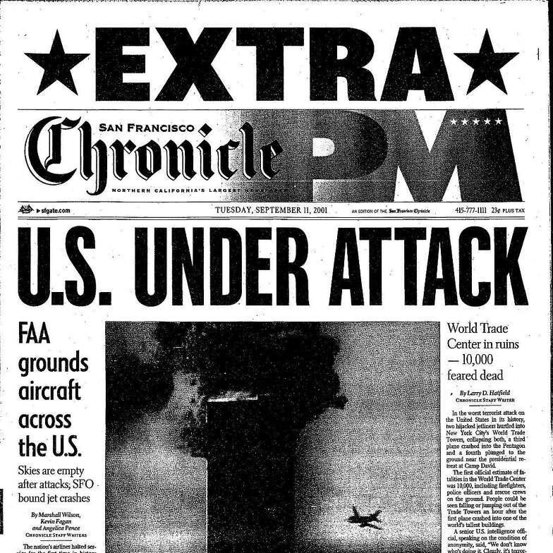 """The front page of The San Francisco Chronicle PM edition on Sept. 11, 2001 shows a plane heading toward the smoldering World Trade Center towers under the headline """"U.S. Under Attack."""""""