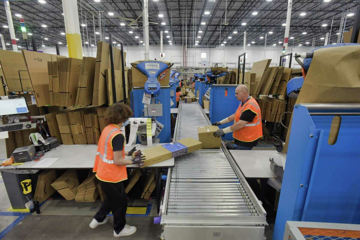 Amazon workers in June 2021 at an order fulfillment warehouse in Schodack, N.Y. (Paul Buckowski/Times Union)