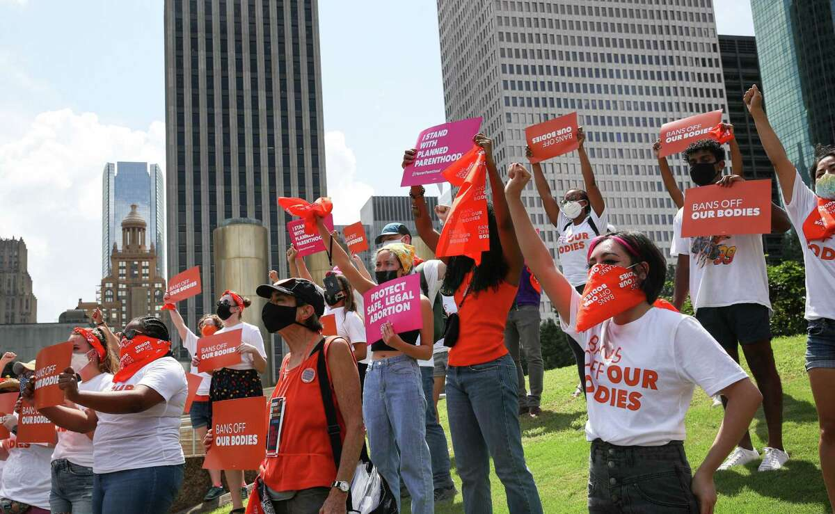 People demonstrate against a new Texas law that bans abortions as early as six weeks into a pregnancy, on Wednesday, Sept. 1, 2021, at Tranquillity Park in Houston. The law also empowers private citizens to sue those who defy the law.