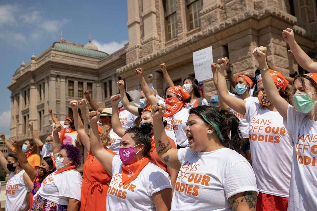 Women protest against the six-week abortion ban at the Capitol on Wednesday September1, 2021. Dozens of people protested the abortion restriction law that went into effect Wednesday.