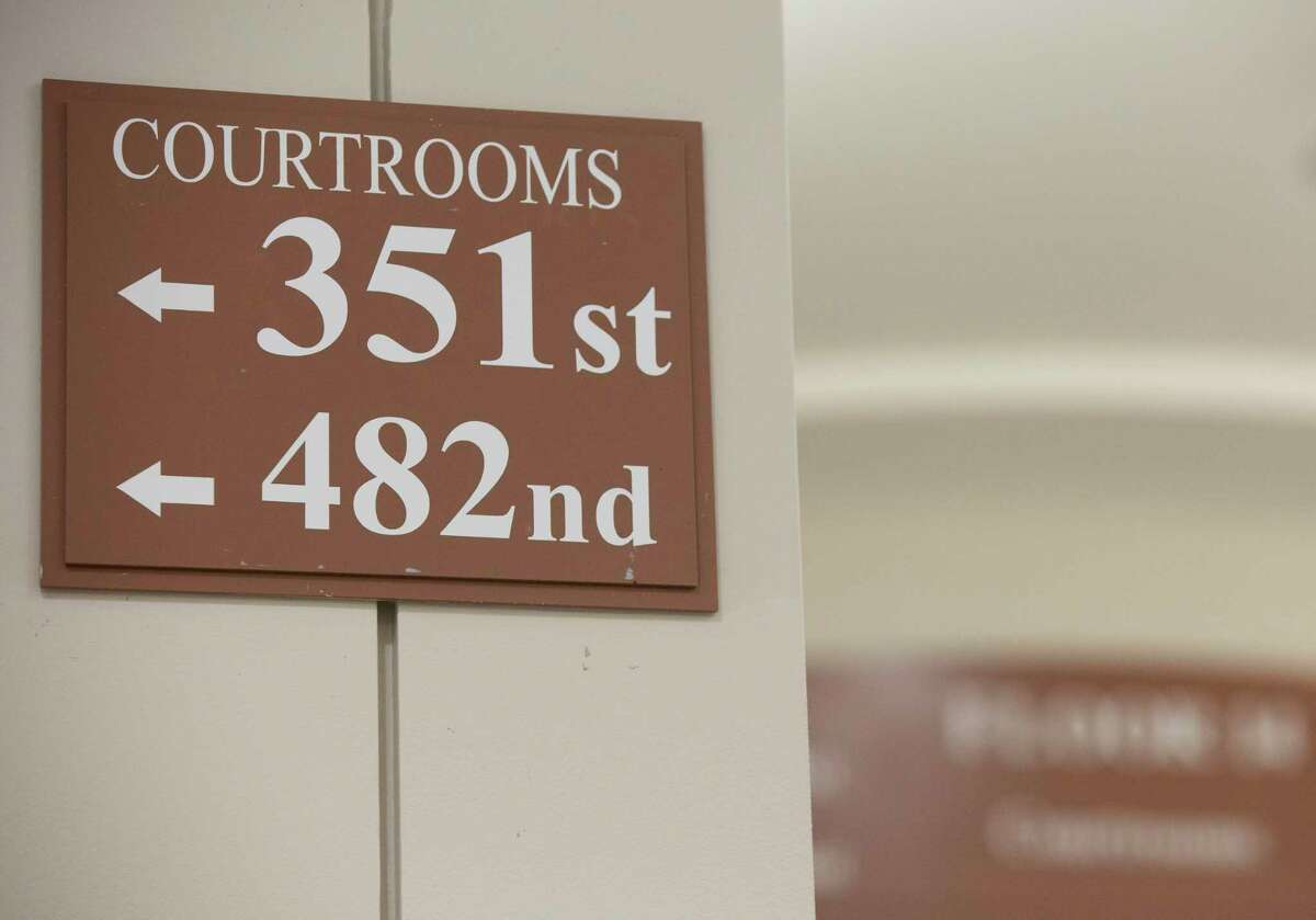 A sign on the hallway pointing the direction for the 482nd Judicial District Court Wednesday, Sept. 1, 2021, at Harris County Criminal Courts at Law in Houston. Wednesday was the first day of Harris County's newest felony court -- the first to open since the 1980s.