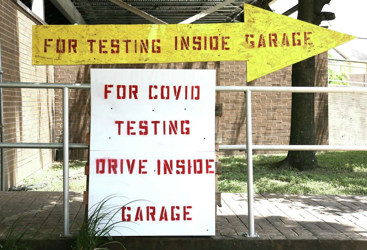Signs for testing offered by Genview Diagnosis in Houston on Tuesday, Aug. 10, 2021.