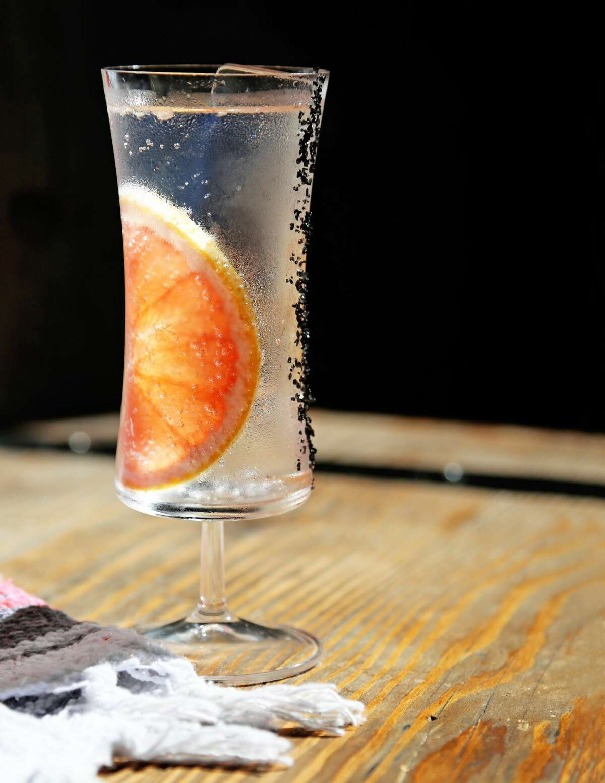"""Traveler's """"A Clear Classic"""" cocktail, made with tequila, mezcal, clear grapefruit and lime, bubbles and salt."""