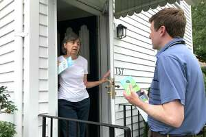 State Rep. Sean Scanlon, executive director of the Tweed New Haven Airport authority, has spent many hours knocking on doors to reach neighbors of the airport as Tweed seeks to expand. He's shown talking with an opponent of the plan on Stuyvesant Avenue, Toni Ginnetti, who knows Scanlon's mother and recalled meeting him as a teenager. Scanlon is a Democrat from Guilford but does not present himself as a state politician while working for Tweed.