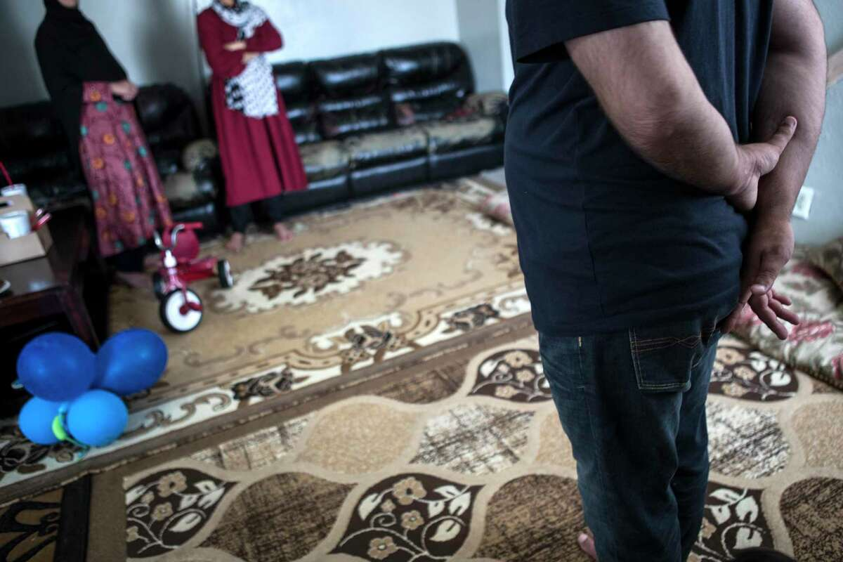 """""""Khan,"""" a Special Immigrant Visa holder, stands in an apartment after fleeing the Taliban in Afghanistan on Monday, Aug. 23, 2021 in Houston. Afghans who do not have Special Immigrant Visas are now arriving in Houston."""