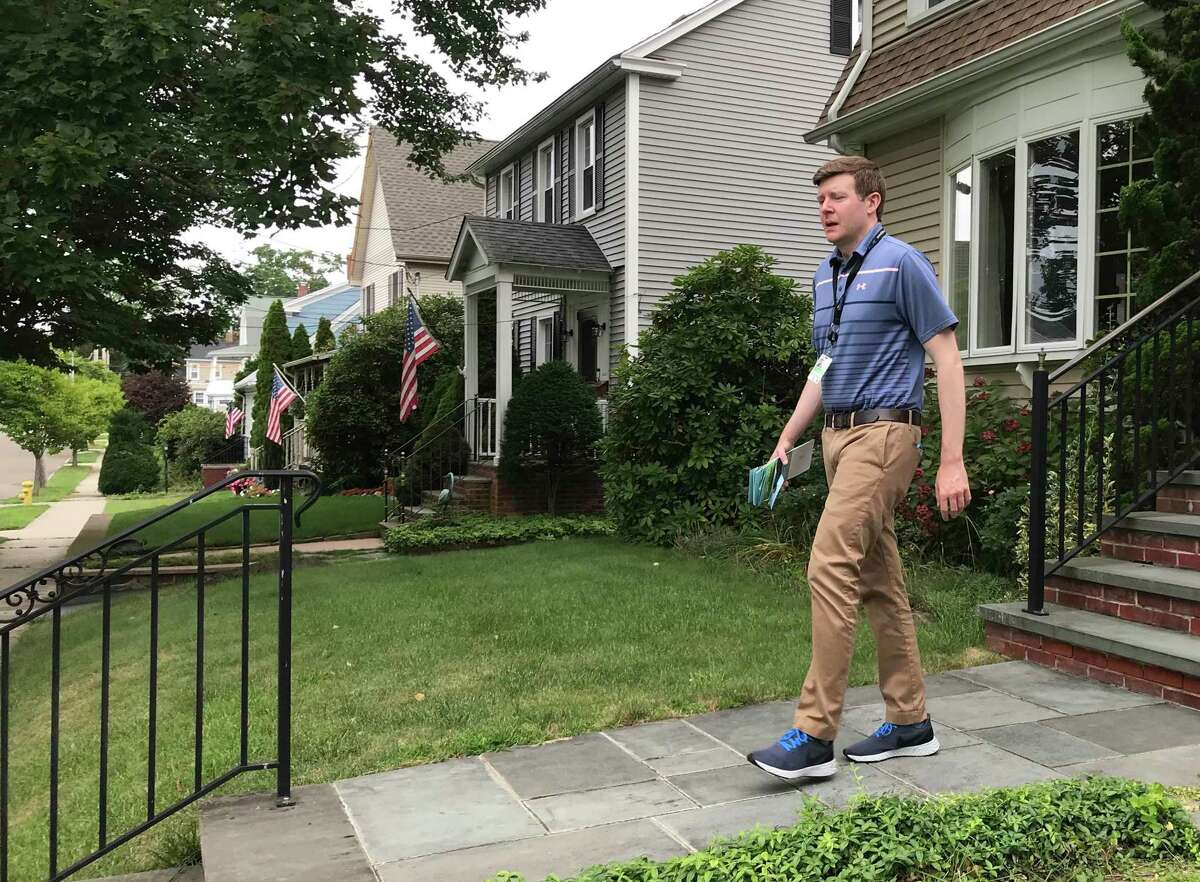 State Rep. Sean Scanlon, executive director of the Tweed New Haven Airport authority, has spent many hours knocking on doors to reach neighbors of the airport as Tweed seeks to expand. He's shown on Stuyvesant Avenue in New Haven.