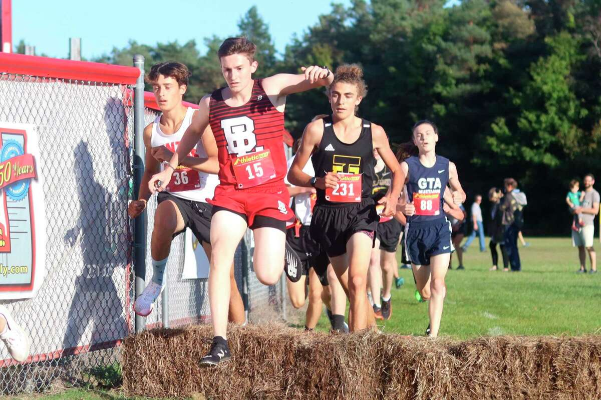 Bear Lake's Kaden Forward hurdles a hay bale early in Wednesday's race. (Robert Myers/News Advocate)