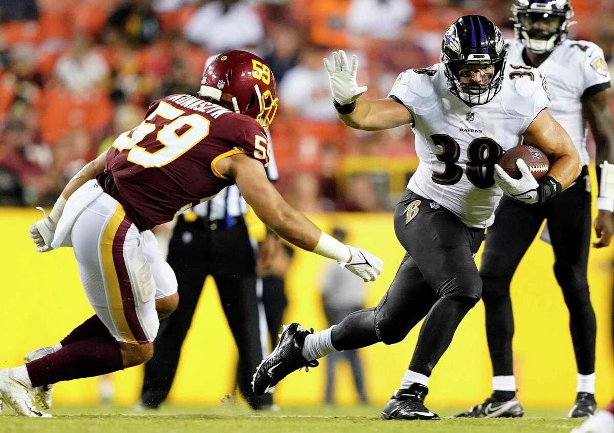 Baltimore Ravens tight end Ben Mason (38) runs with the ball as Washington Football Team's Jordan Kunaszky (59) moves in during a preseason NFL football game, Saturday, Aug. 28, 2021, in Landover, Md. (AP Photo/Carolyn Kaster)