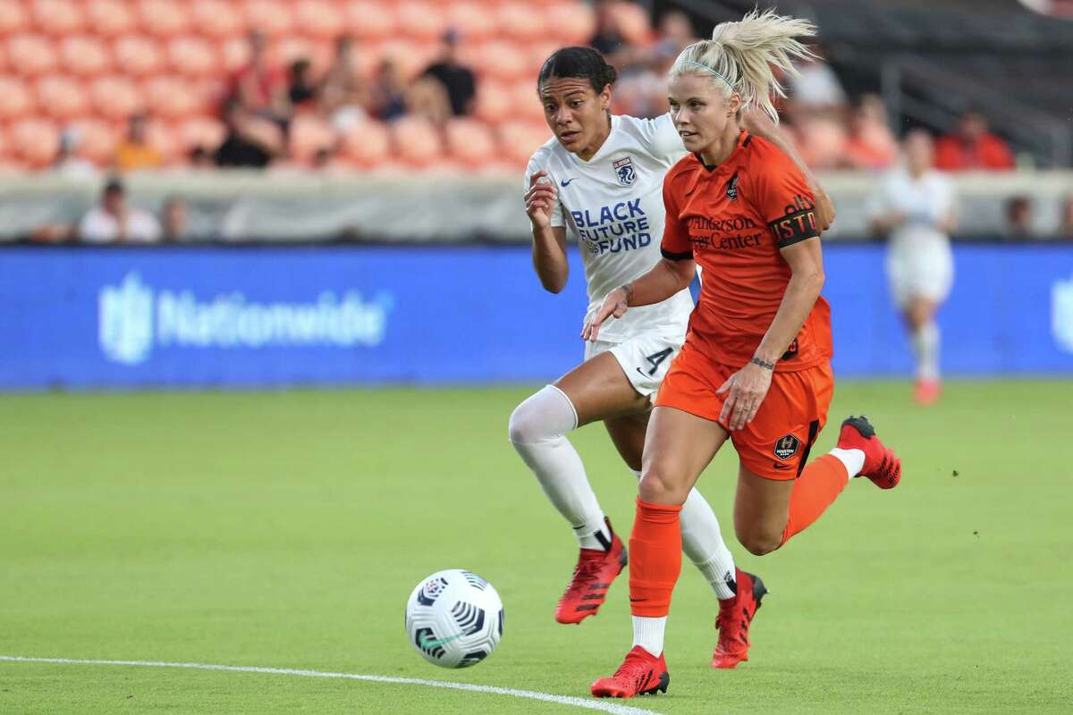 Houston Dash forward Rachel Daly (3) runs past OL Reign defender Alana Cook (4) as she breaks away down the field during the first half of an NWSL soccer match on Wednesday, Sept. 1, 2021, in Houston.