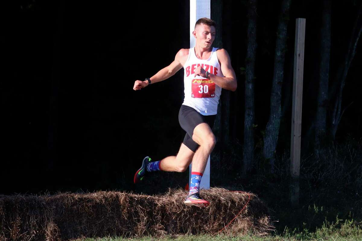 Race winner Hunter Jones comes surging over a hay bale and out of the woods on Sept. 1. (Robert Myers/Record Patriot)