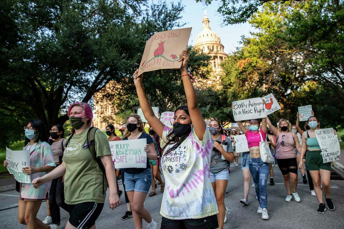 Students protest at the Texas Capitol against Texas?•s new law that effectively bans abortions after six weeks in Austin, Tx., U.S. on Wednesday, September 1, 2021. Texas Senate Bill 8, SB8, that effectively bans abortions after six weeks in the state of Texas went into effect on Wednesday, September 1, 2021. The Austin Students for a Democratic Society along with the Feminist Action Project organized and held a protest against the implementation of the new law outside the Texas Capitol.