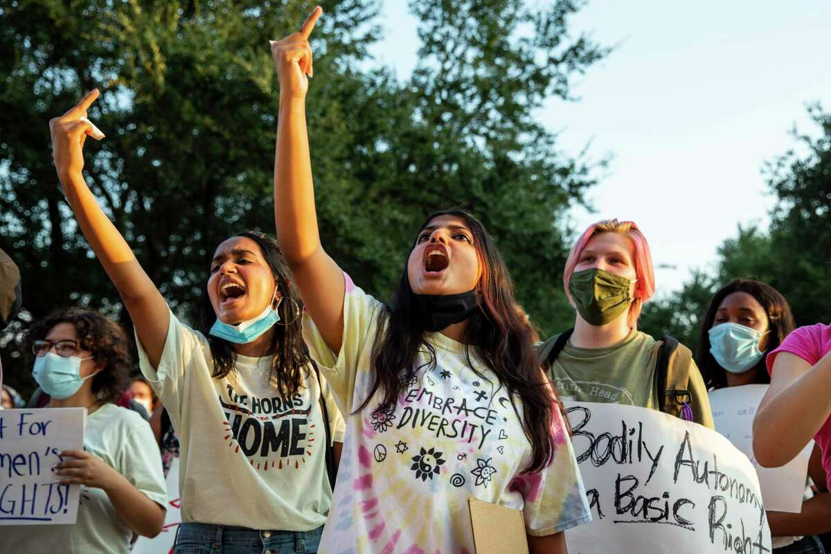 University of Texas students Amaya Sankaran, 18, left, and Anu Pillai, 18, center, yell at any remaining legislators left in the Texas Capitol building during a protest against Texas?•s new law that effectively bans abortions after six weeks in Austin, Tx., U.S. on Wednesday, September 1, 2021. Texas Senate Bill 8, SB8, that effectively bans abortions after six weeks in the state of Texas went into effect on Wednesday, September 1, 2021. The Austin Students for a Democratic Society along with the Feminist Action Project organized and held a protest against the implementation of the new law outside the Texas Capitol.