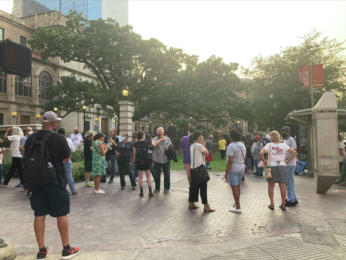 Food Not Bombs advocates for the unhoused meet outside of the Downtown Houston Public Library for a press conference Wednesday evening.