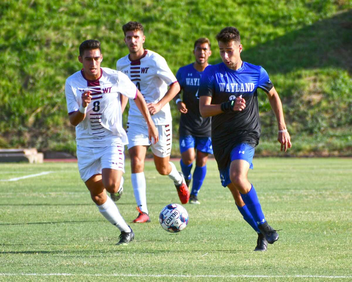 Wayland Baptist's Marco Magnoli races past West Texas A&M defender Bryan Martinez during their men's soccer game on Wednesday at Hilliard Field.