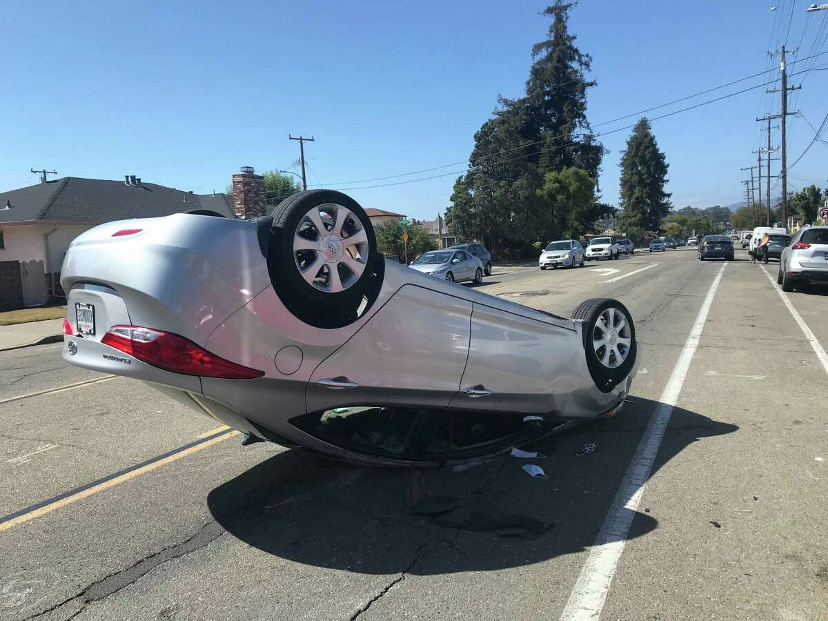 A car that overturned after striking a San Leandro High School student