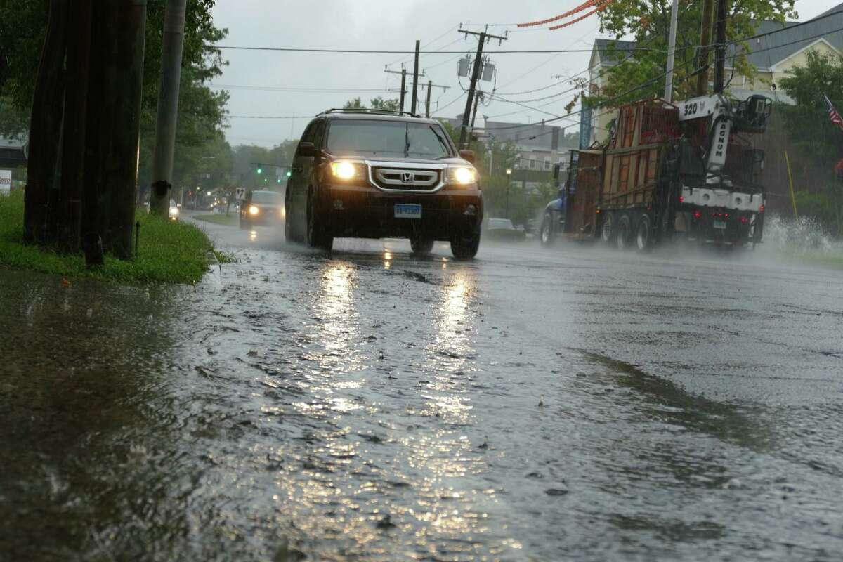 Mild flooding impacted drivers on Main Street in Danbury on Wednesday, Sept. 1, as the remnants of Hurricane Ida dumped heavy rain across the region.
