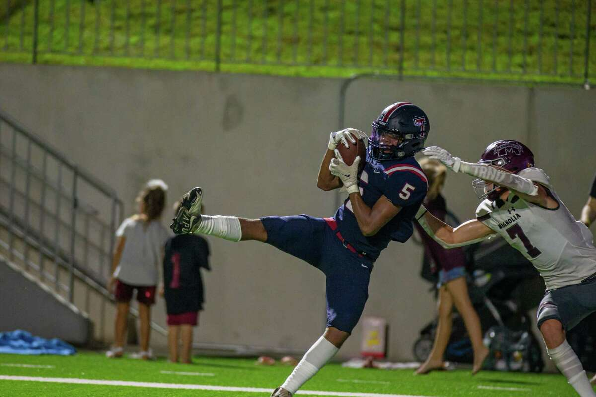 Tompkins Falcons DB Maliik Edwards (5) makes an interception in front of Magnolia Bulldogs WR Ethan King (7) during second half of action between Tompkins Falcons vs. Magnolia Bulldogs during a high school football game at the Legacy Stadium, Saturday, August 28, 2021, in Katy. Tompskins Falcons defeated Magnolia Bulldogs 18-6. (Juan DeLeon/Contributor)