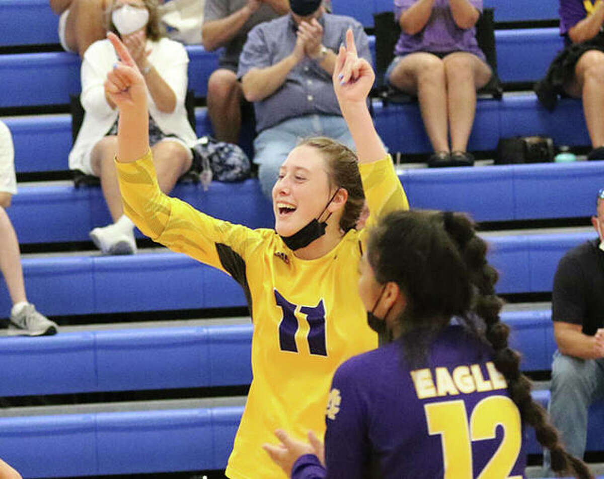 CM's Lauren Dunlap (11) celebrates a point during the Roxana Tournament last week in Roxana. On Wednesday, Dunlap had a team-high seven kills in a win at Granite City that moved the Eagles' record to 8-0