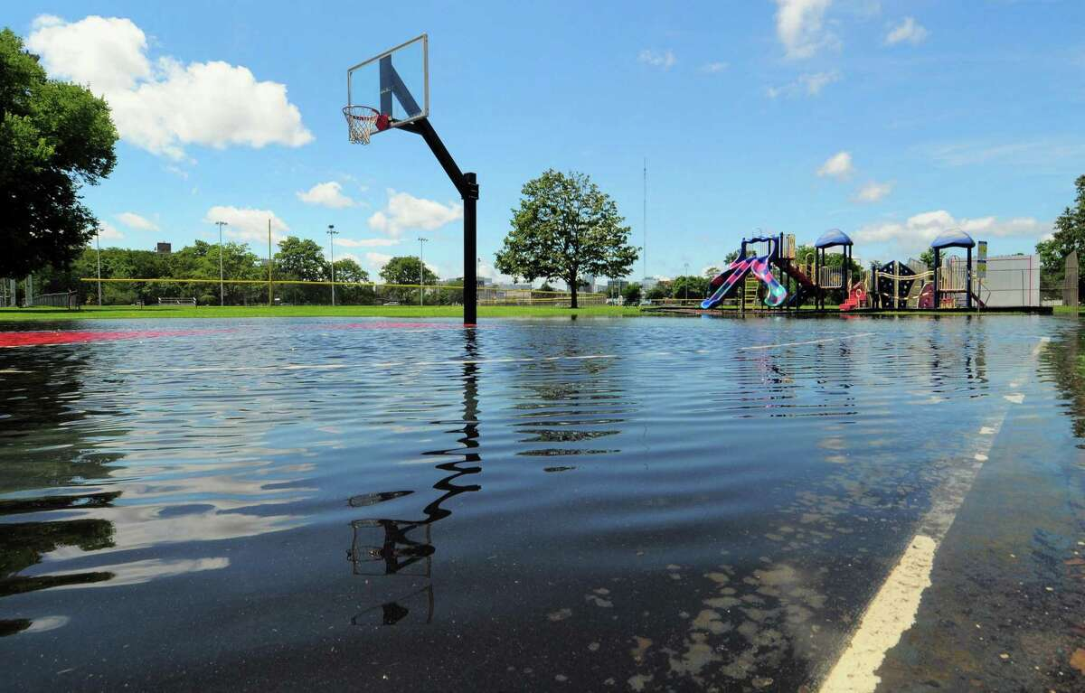 The flooded basketball court at Cummings Park after the July 9 rain from Isaias. Flooding from Ida dumped nearly 7 inches of rain on Stamford overnight.