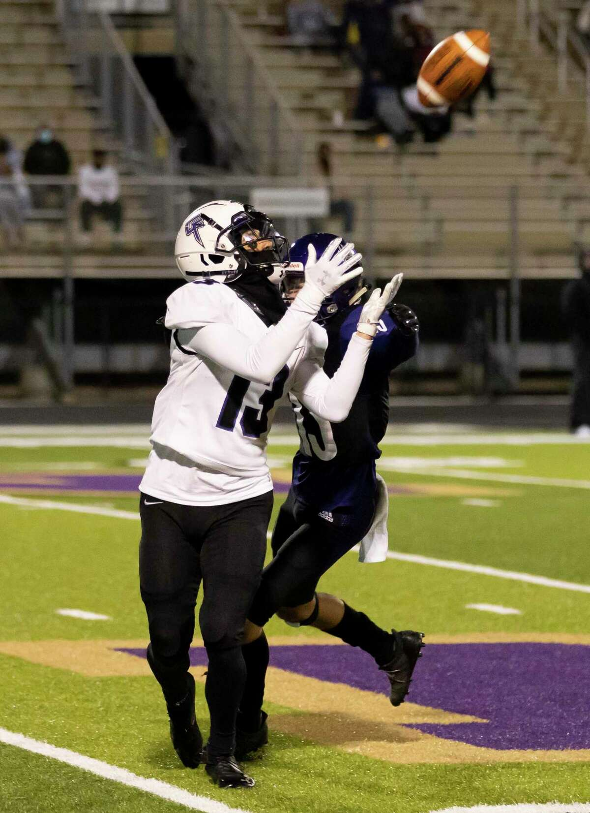 Fulshear wide receiver Jax Medica (13) catches a pass while under pressure from Montgomery center back KJ Danes (13) during the fourth quarter of a District 10-5A (Div. II) football game at MISD Stadium in Montgomery.