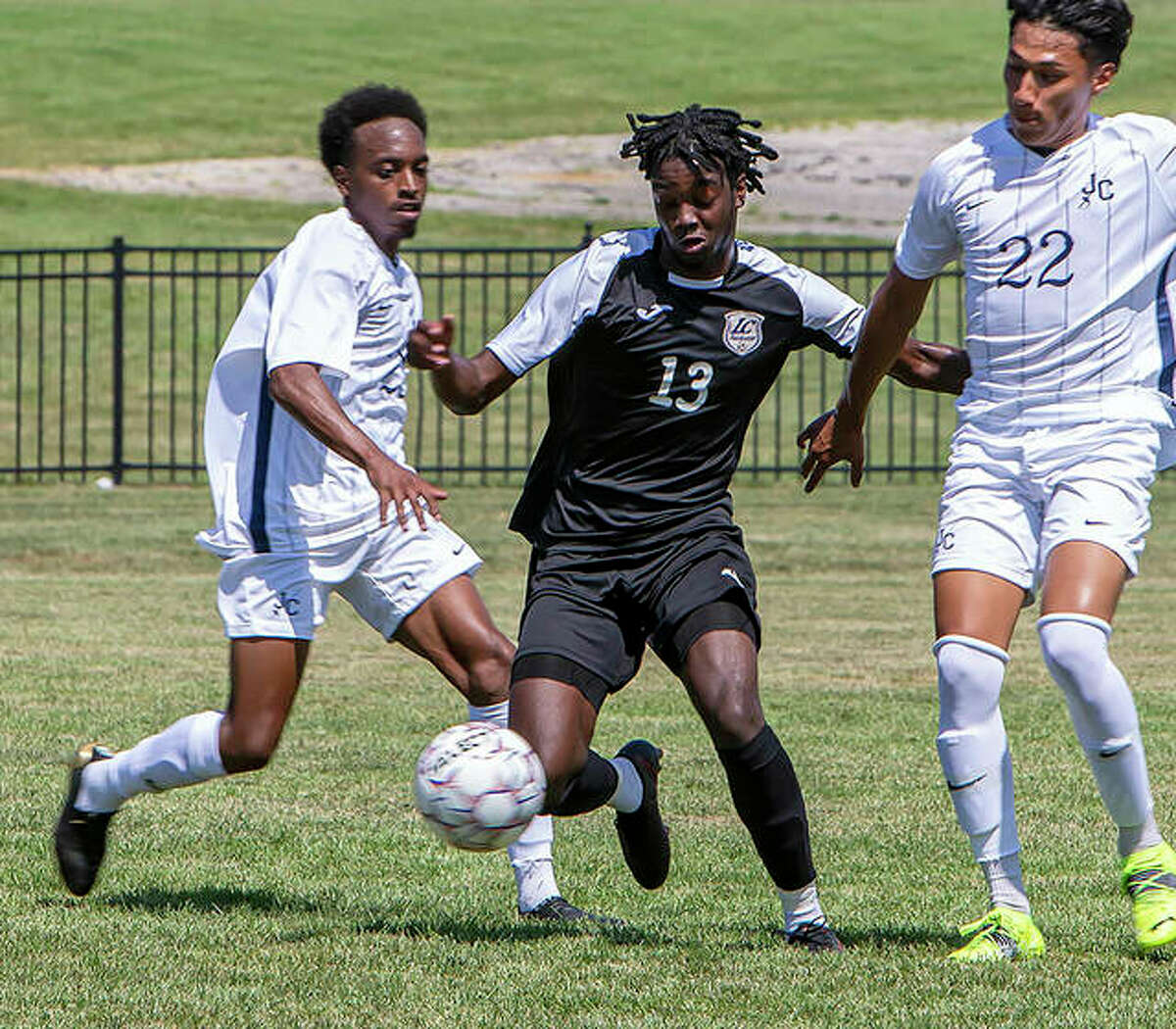 LCCC Ashley Martin, center, carries the ball between a pair of defenders Sunday against Johnson city. On Wednesday, LCCC fell at Mineral Area College 4-3.
