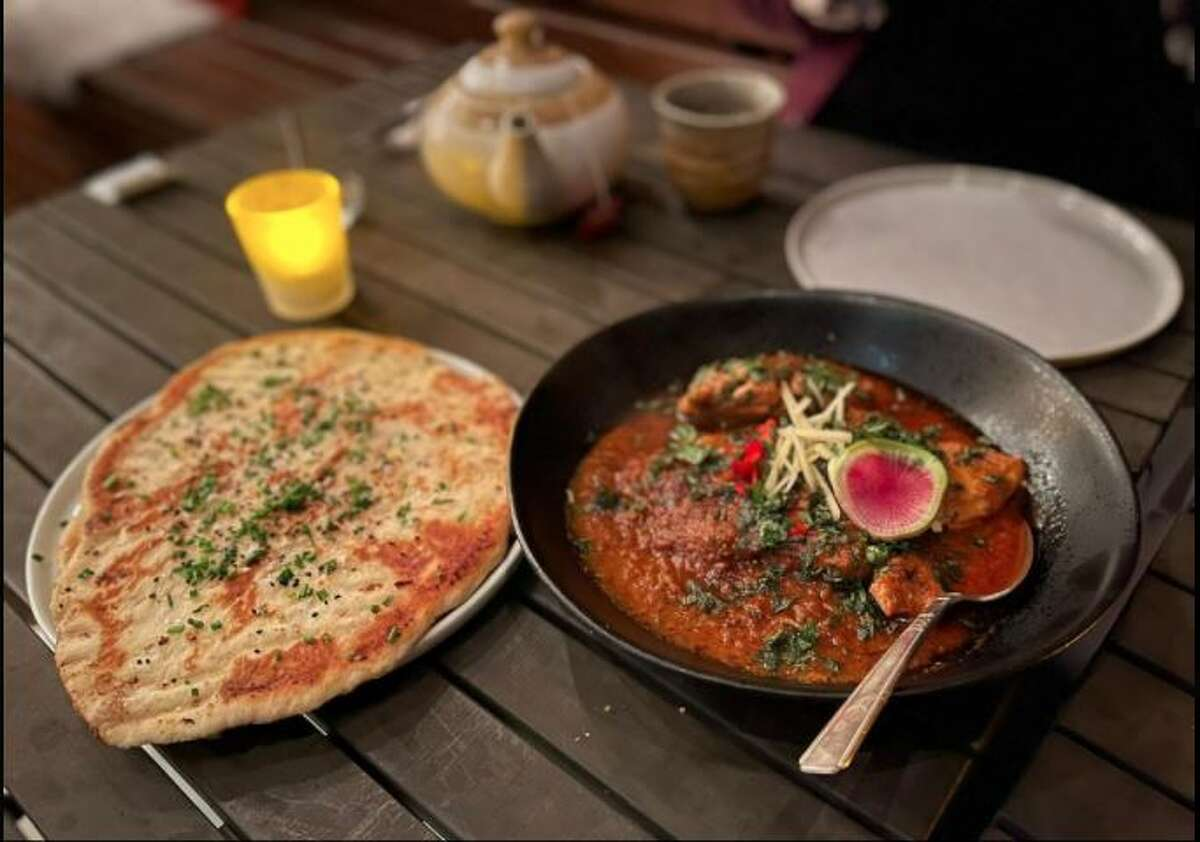 Naan with butter chicken masala from Meesha