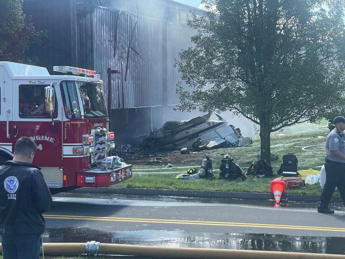 Firefighters working to put out fire from the crash on Hyde Road at the Trumpf facility in Farmington, Thursday, Sept. 2, 2021.