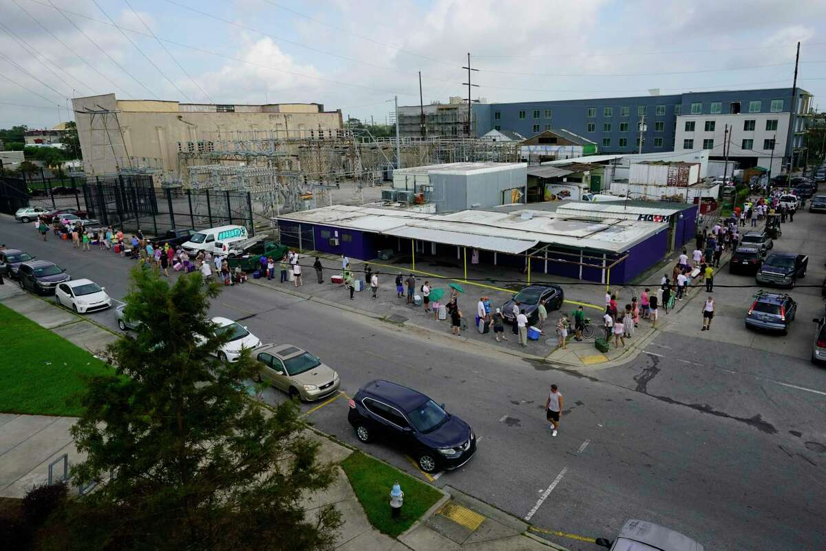 In the aftermath of Hurricane Ida people lining up for food and ice at a distribution center Wednesday, Sept. 1, 2021, in New Orleans, La.